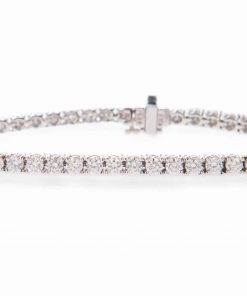 pre-owned Platinum Diamond tennis bracelet with 5.5 carats of round brilliant cut diamond