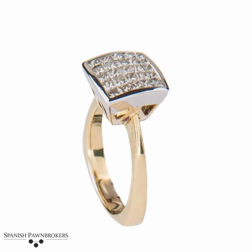 Pre-owned Diamond Cocktail Ring set with 12 princess cut diamonds in an illusion setting made of 18-carat yellow gold