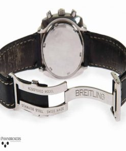 Pre-owned vintage Breitling top time model 2211 watch with black dial on leather strap with deployment buckle
