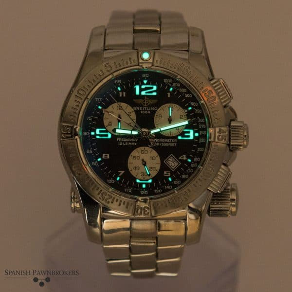Second hand luxury watch Breitling Emergency Mission A73321 under black light